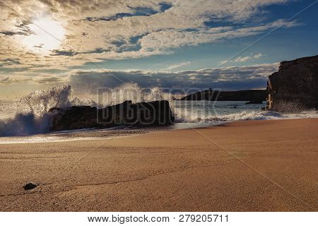 French Landscape - Waves. A Beautiful Beach With Wild Cliffs In The Background At Sunset.