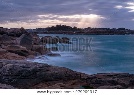 French Landscape - Bretagne. View Over The Famous Pink Granite Coast At Sunset.