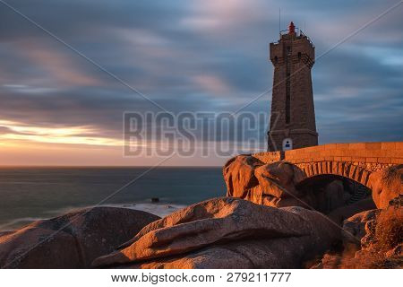 French Landscape - Lighthouse. View Over The Famous Pink Granite Coast And The Lighthouse Men Ruz At