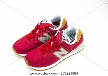 Boston, Ma, Usa, January 2019 - New Balance Nb 574 Red Athletic Shoes On Studio Background. New Bala