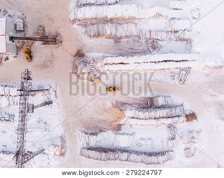 Industrial Photo, Storage Of Wooden Logs Under The Snow At A Sawmill. Top View Aerial.