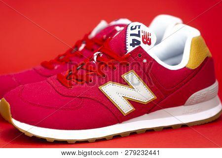 Boston, Ma, Usa, January 2019 - Red New Balance Nb 574 Athletic Shoes On Studio Background. New Bala