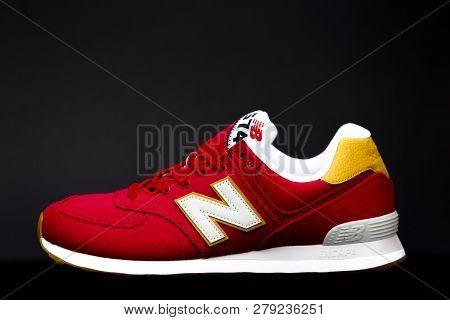 Boston, Ma, Usa, January 2019 - Red New Balance Nb 574 Athletic Shoes On Black Studio Background. Ne