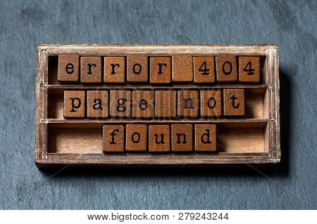 Error 404 Page Not Found Concept. Vintage Box, Wooden Cubes With Old Style Letters. Gray Stone Textu