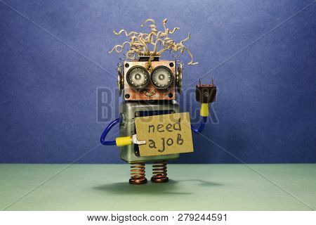 Robot Looking For A Job. The Crazy Unemployed Toy Robot Holds Cardboard Announcement Handwritten Tex