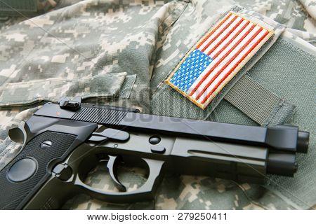 Handgun Over Solder's Uniform - Studio Shot