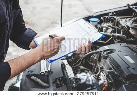 Services Car Engine Machine Concept, Automobile Mechanic Repairman Checking A Car Engine With Inspec