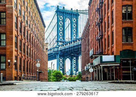 Manhattan Bridge Between Manhattan And Brooklyn Over East River Seen From A Narrow Alley Enclosed By