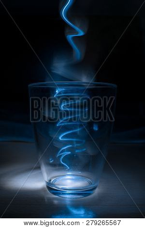 In The Image Can See A Lantern Light Inside Of A Glass. This Looks Like An Aura.