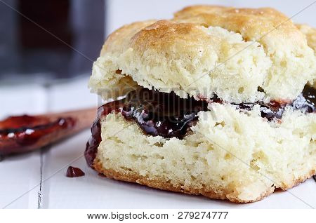 Buttermilk Southern Biscuit With Raspberry Or Strawberry Jam Or Jelly. Extreme Shallow Depth Of Fiel