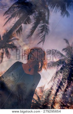 Beautiful Young Boho Woman On Tropical Background At Sunset