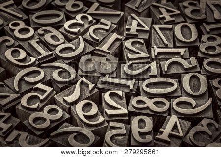 random number background - vintage letterpress wood type, black and white image