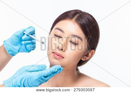 Young Asian Woman Is Getting Collagen Injection Into Her Face. Beauty Female Face Surgery Close Up P