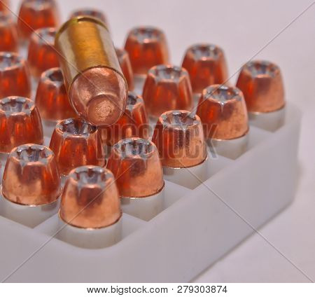 40 Caliber Hollow Point Bullets In A Plastic Case With A Single Full Metal Jacket .40 Caliber Bullet