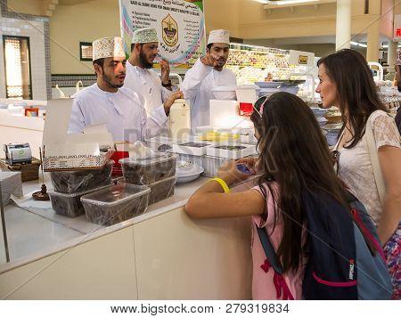 Nizwa, Oman - November 2, 2018: Tourists Talk To Omani Sellers At The Friday Souk In Nizwa