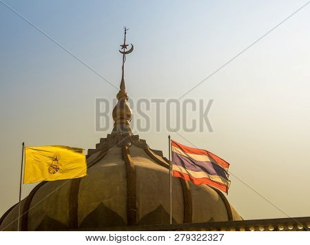 Thai Flag And The Flag Of The King In Front Of The Mosque Building With Evening Sky