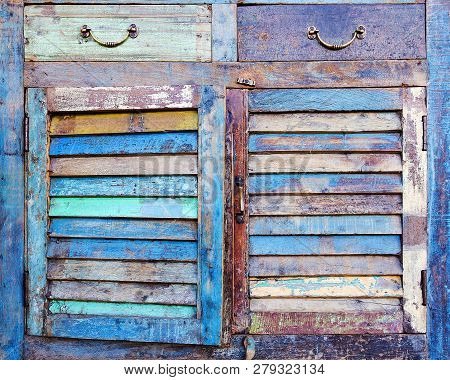 facade of an old dresser. colorful furniture poster