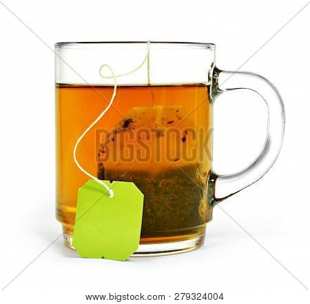 Cup Of Tea With Tea Bag And Copy Space, Isolated On White Background. Hot Drink, Herb Tea Or Assam O