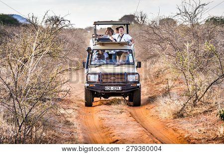 Tsavo East Reserve, Kenya - October 11, 2018: Safari Cars With Unindentified Tourists On Adventure T