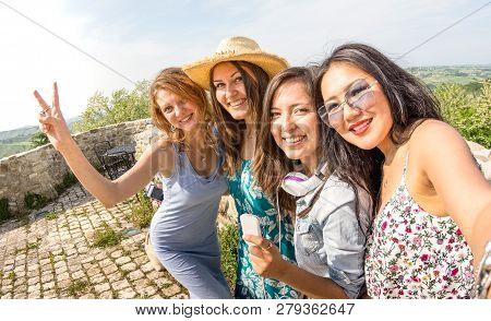 Four Multiracial Millennial Girlfriends Taking Selfie At Country Side Excursion - Happy Girls Having