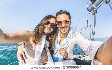 Young Lover Couple Taking Selfie On Sailing Boat Tour Around The World - Love Concept At Jubilee Par