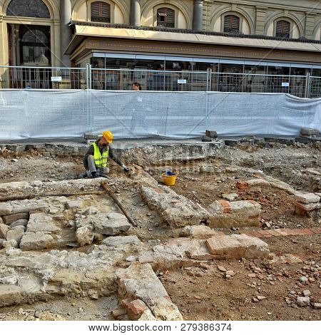 Archaeological Excavations In Florence. Archaeologist At Work. Antique Settlement In The Old Town. R