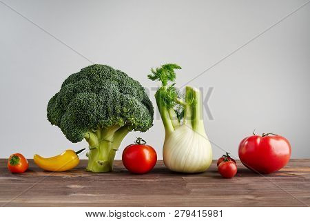 Fresh Peper, Broccoli, Tomato On Wooden Background. Still Life With Raw Vegetable. Concept Of Health