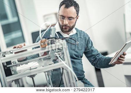 Serious Professional Adult Engineer Testing 3d Printer