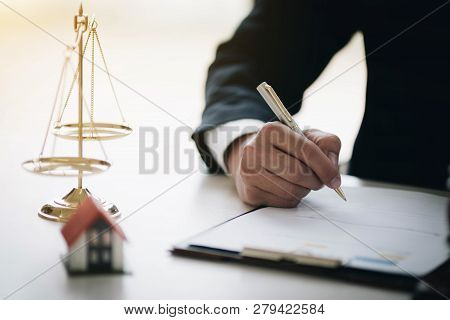 Male Lawyers Working At The Law Firms.home Loan Insurance, Real Estate Law Concept.