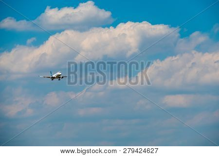 Passenger airplane flying in the cloudy sky