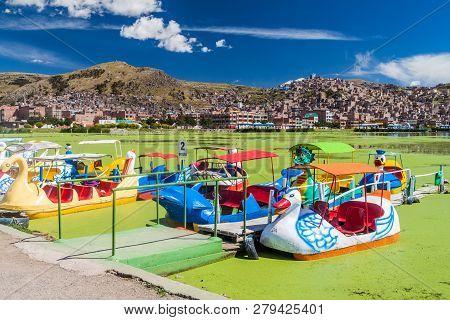 Puno, Peru - May 14, 2015: Swan Shaped Tourist Boats In A Port Of Puno, Peru