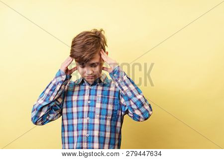 stress, headache, emotional breakdown, mind overload, frightened displeased boy clutching head over yellow background, banner or poster template, emotion facial expression, people reaction poster