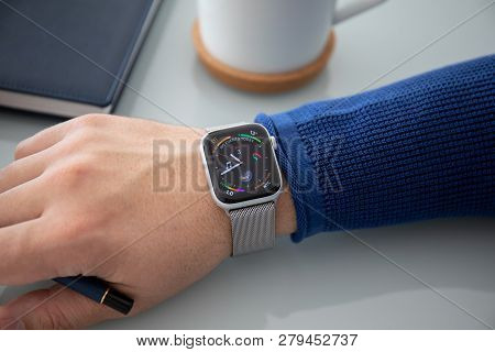 Alushta, Russia - November 3, 2018: Man Hand With Apple Watch Series 4 Over The Table. Apple Watch W