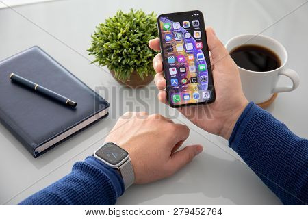 Alushta, Russia - November 3, 2018: Man Hand With Apple Watch Series 4 And Iphone X On The Table. Ap