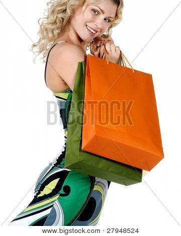Shopping. Beautiful woman with colour packages