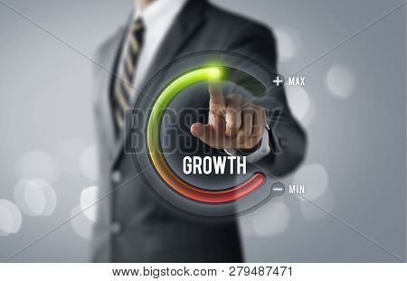 Business Growth Or Career Growth Concept. Businessman Is Pulling Up Circle Progress Bar With The Wor