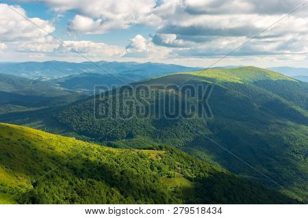 Beautiful Landscape Of Carpathian Mountains. Grassy Alpine Meadows, Deep Valleys. Wonderful Sunny We