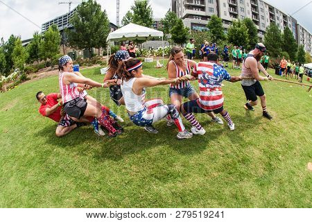 Atlanta, Ga - July 2018:  A Team Of Young Adult Men And Women Struggle To Pull The Rope In A Tug Of