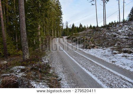 Winding Gravel Road Through The Woods In Winter Season