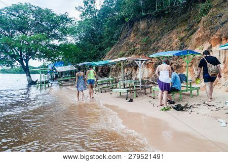 Manaus, Brazil - July 25, 2015: People At Praia Da Ponta Negra Beach During High Water Level.