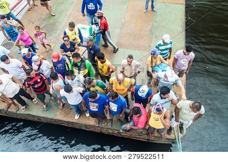 Oriximina, Brazil - June 28, 2015: Passengers And Sellers Wait For A Boat On A Pier In Oroxomina Tow
