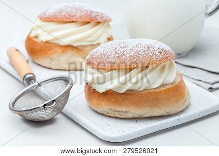 Traditional Swedish Dessert Semla Or Shrove Bun, With Almond Paste And Whipped Cream Filling, Served