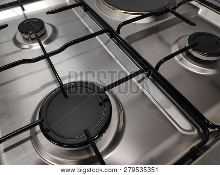 Close Up Shot Of A Free Standing Mixed Fuel Stainless Steel Gas Hob With One Solid Hotplate