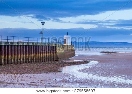 Seaside Town Of Nairn, Scotland. The Concrete Pier Forms The Entrance To The Harbour.