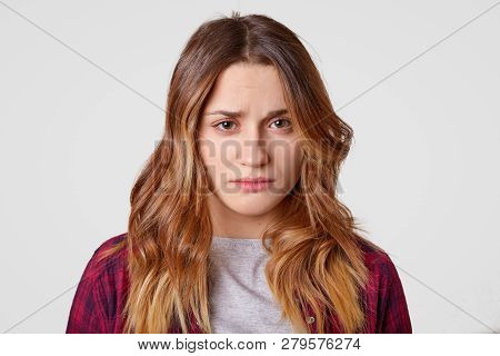 Sad Young Woman With Sorrowful Expression Feels Frustrated, Has Long Hair, Has Healthy Skin, Express