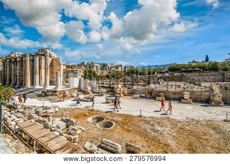 Athens, Greece - September 17 2018: Tourists Sightsee At The Ancient West Wall Of Hadrians Library A