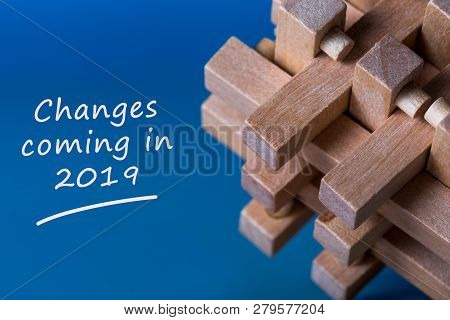 A Note Changes Coming In 2019. With Wooden Break Teaser At Blue Background
