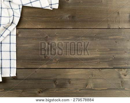 Blue And White Checkered Dishcloth On Brown Rustic Wooden Plank Table Flat Lay Top View From Above W