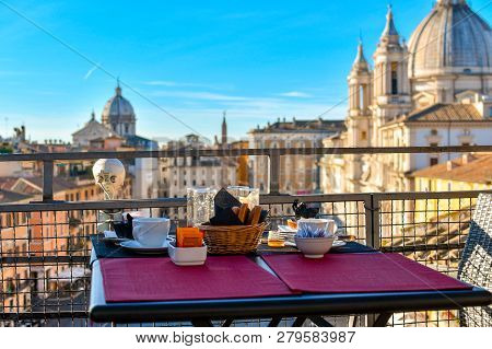 Rome, Italy - September 29 2018: Leftovers From A Continental Breakfast On A Roof Top Bar Overlookin