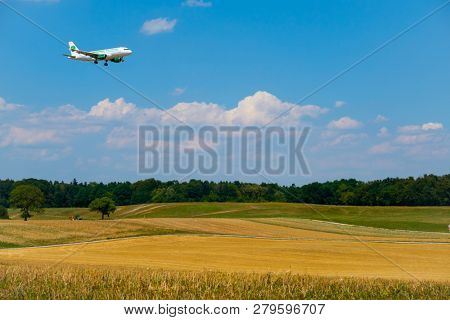 Zurich, Switzerland - July 19, 2018: Germania airlines airplane preparing for landing at day time in international airport